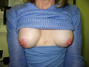 Horny milf shows off her big tits and hairy pussy