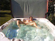 Bbw spreads her legs and displays her breasts in jacuzzi