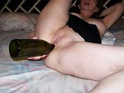 Mature wife uses champagne bottle and dildo to get off