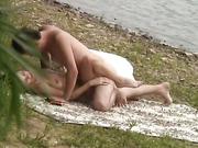 Hot ass brunette rides a hard cock b the lake voyeur hidden in bushes